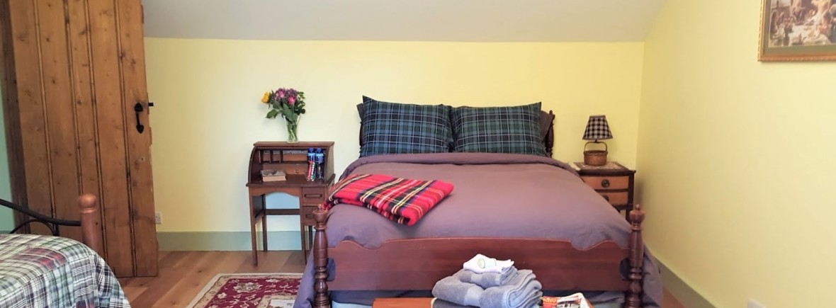 The Honeysuckle Room is a family room at the Ballaghboy Lodge Farm, Co. Sligo, Ireland. Perfect place for group retreats, or family self-catering stay at a farm. This room features a full sized bed and a trundle bed that can be opened up into a King size bed.  This room can comfortably accommodate up to 4 people.